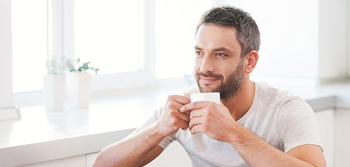 Man starting day with coffee